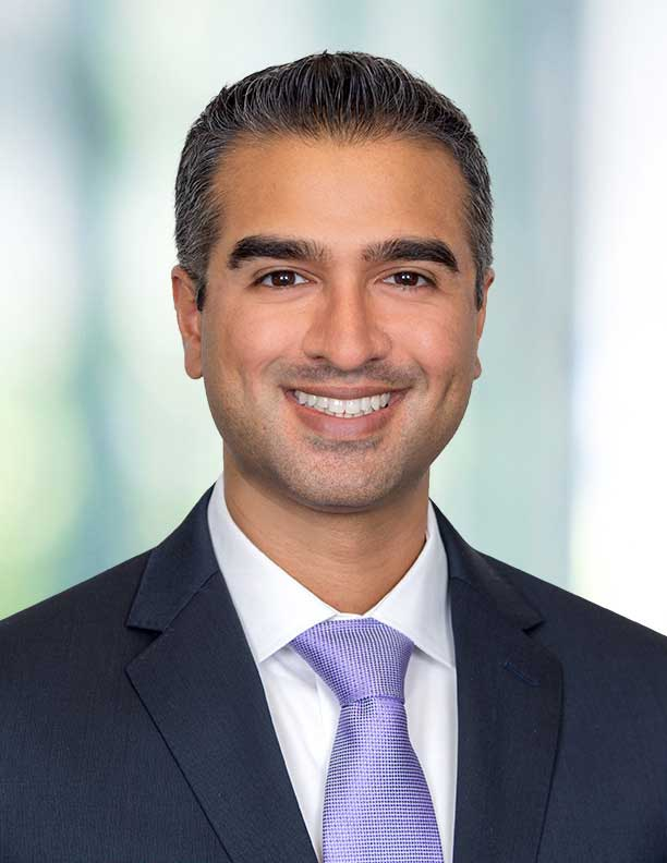 corporate headshot of lawyer on blurred background