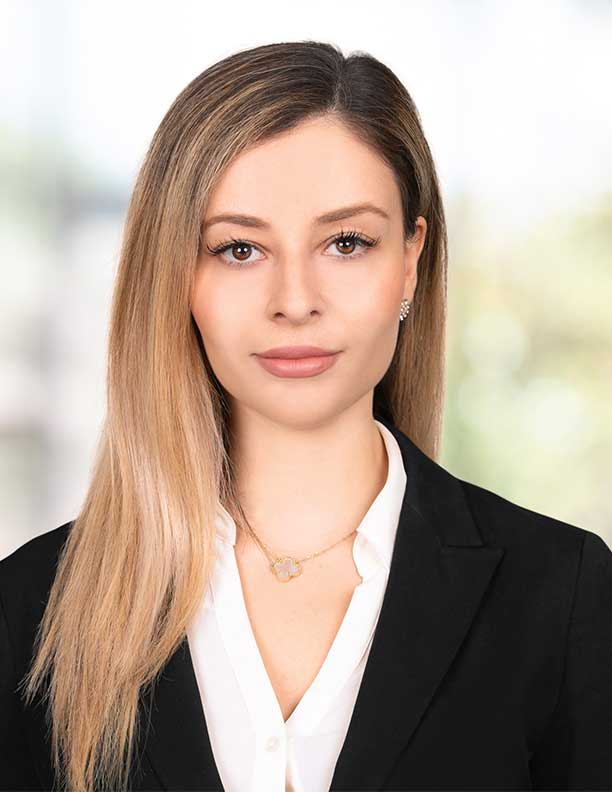 corporate headshot of female lawyer soft smile no teeth