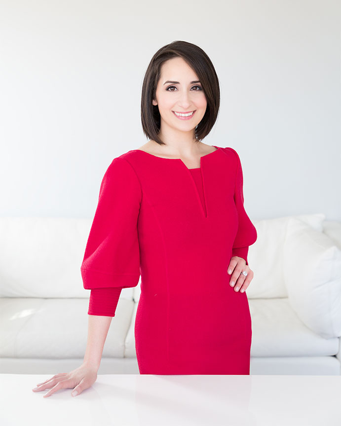 portrait of woman attorney wearing red dress